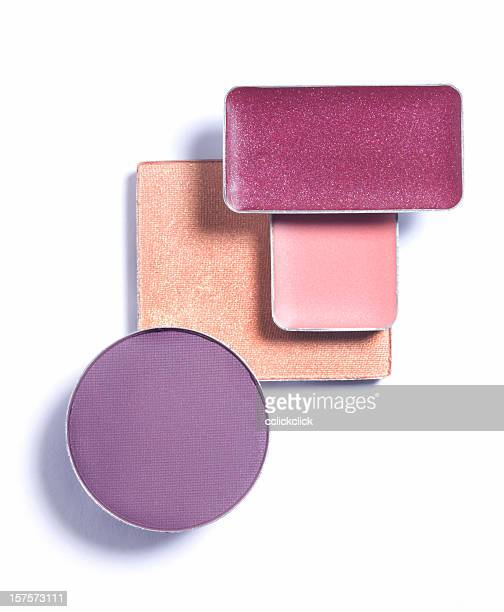 Makeup forms a pastel mosaic of cosmetics