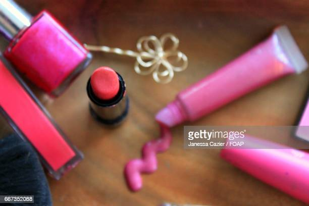 make-up iitems on table - janessa stock pictures, royalty-free photos & images