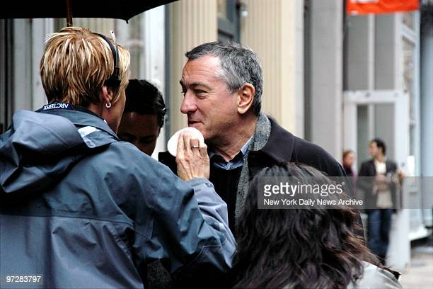 Makeup is applied as actor Robert Di Nero waits to a scene on Mercer St for a commercial for the third annual Tribeca Film Festival and the area's...