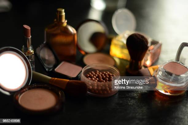 Make-up items and a perfume bottle