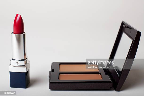 make-up kit with red lipstick - powder compact stock pictures, royalty-free photos & images
