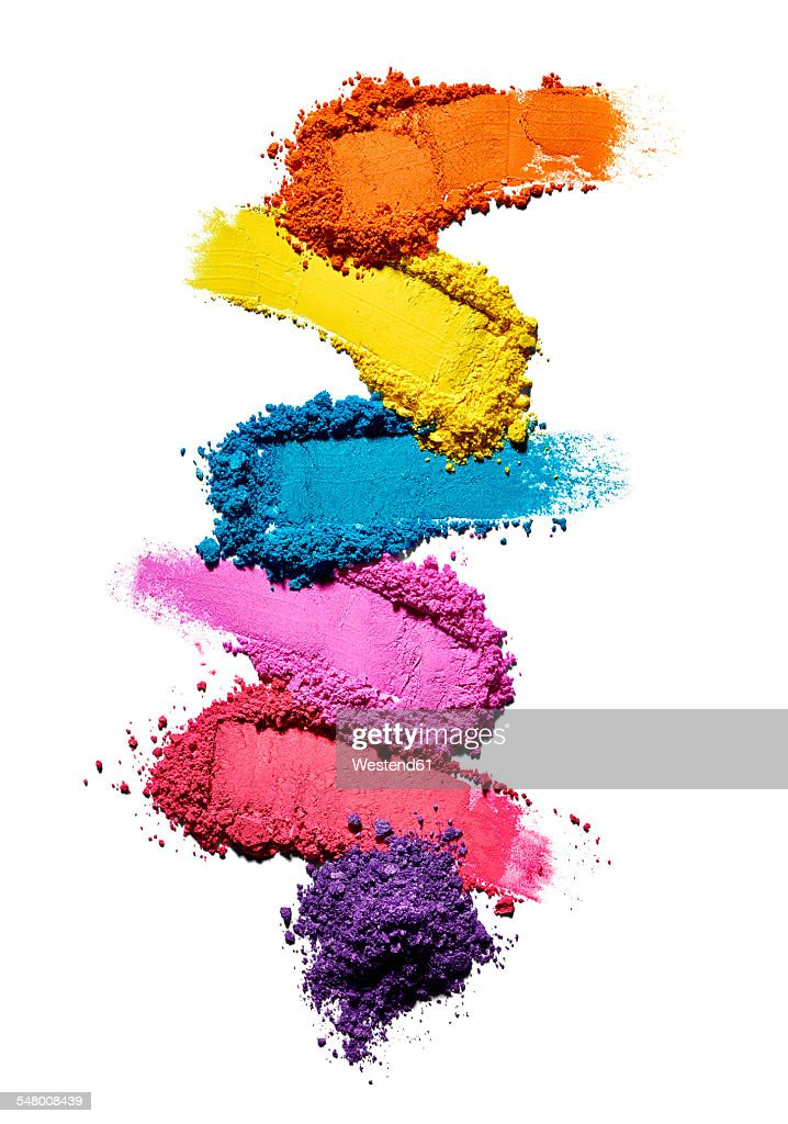 Make-up powder in different colours in front of white background : Stock Photo