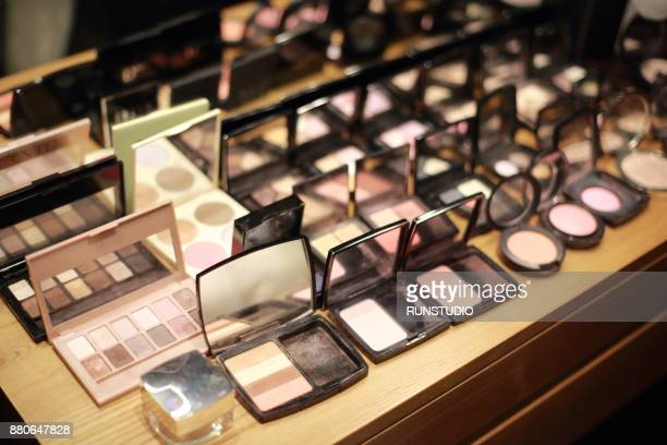 make-up products on table - dressing table stock photos and pictures