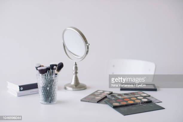 make-up products with mirror against white background - mirror object stock pictures, royalty-free photos & images