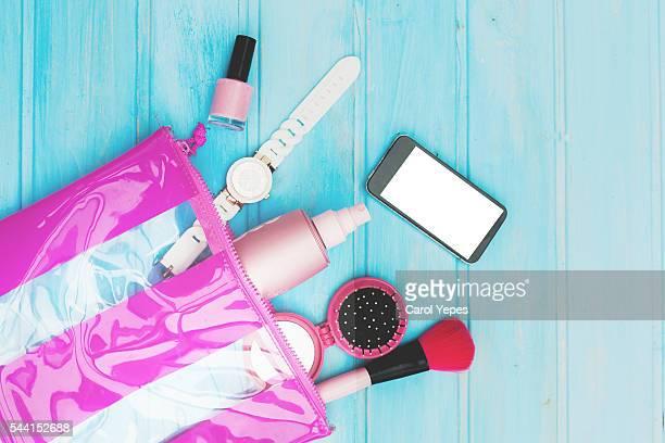 makeup woman bag with smartphone