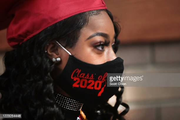 Makeya Butler waits to have her picture taken before receiving her diploma at a graduation ceremony at BradleyBourbonnais Community High School on...