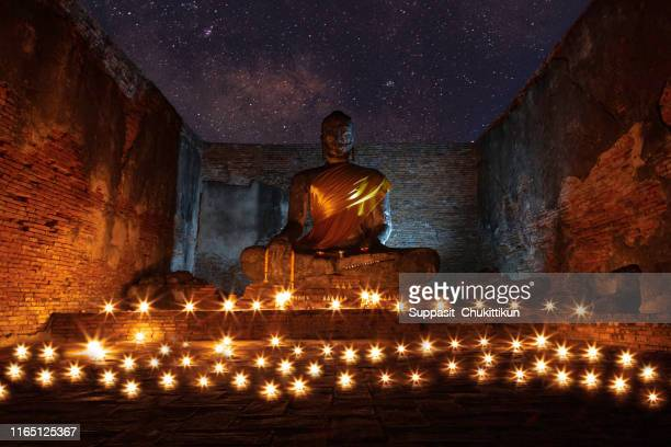 makha bucha day is an important buddhist day.buddhist people will walk with candle at night.at temple of thailand ayutthaya. - ayuthaya province stock pictures, royalty-free photos & images