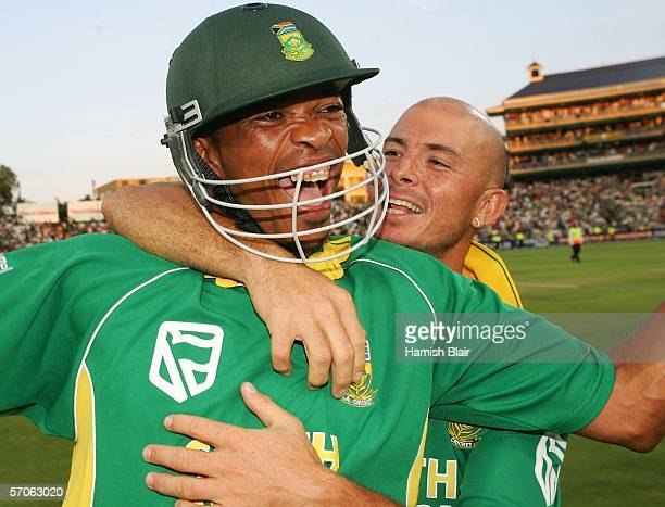 Makhaya Ntini and Herschelle Gibbs of South Africa celebrate their team's one wicket victory during the fifth One Day International between South...