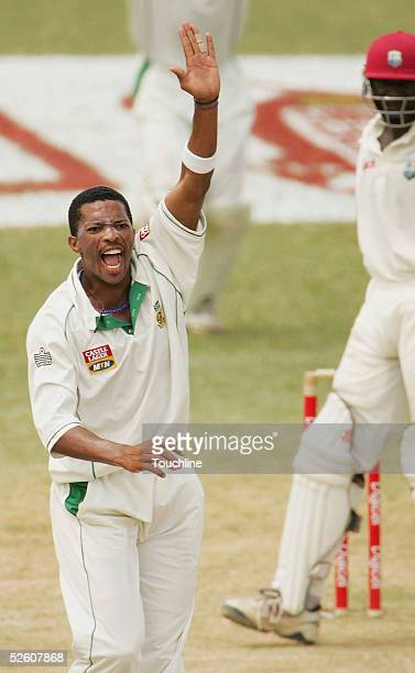 Makhaya Ntini of South Africa celebrates his fifth wicket, the wicket of Courtney Browne of West Indies, during the second day of the second test...