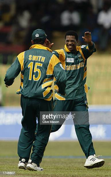 Makhaya Ntini of South Africa celebrates the wicket of Sourav Ganguly of India during the ICC Champions Trophy semifinal match between India and...