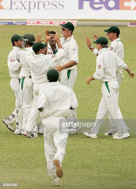Makhaya Ntini of South Africa is congratulated by team-mates after taking the wicket of Ramnaresh Sarwan of the West Indies during the first day of...