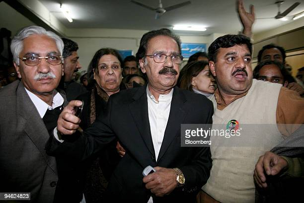 Makhdoom Amin Fahim center vicechairman of Benazir Bhutto's Pakistan Peoples Party and other party leaders leave the hospital in Islamabad Pakistan...