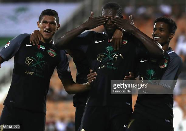 Makhete Diop of Al Ahli celebrates with Luvannor Henrique De Sousa and Waleed Ambar Esmaaeel after scoring a goal during the Arabian Gulf League...