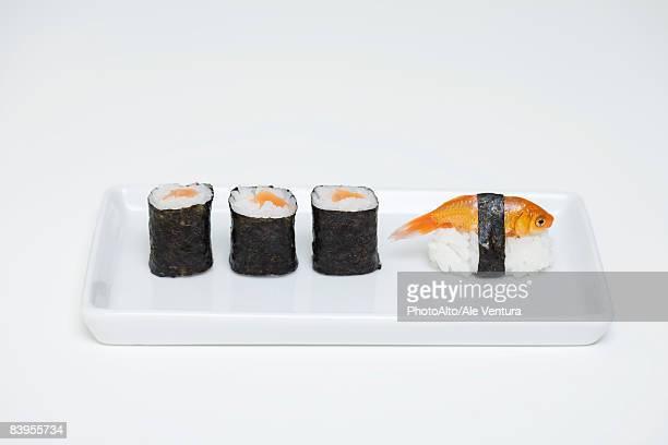 Maki sushi and goldfish nigiri on plate