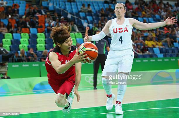 Maki Takada of Japan dives to save the ball as Lindsay Whalen of United States looks on during the Women's Quarterfinal match on Day 11 of the Rio...