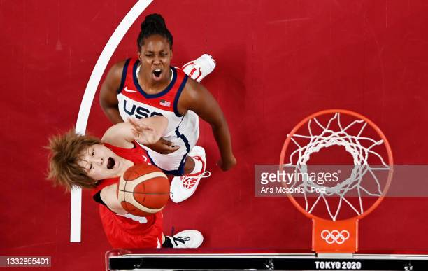 Maki Takada of Team Japan drives to the basket against Chelsea Gray of Team United States during the first half of the Women's Basketball final game...