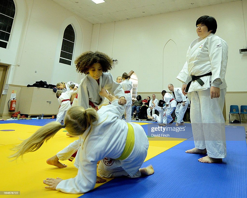 Maki Tsukada closely watches the juniors demonstrating their throws for her during the Maki Tsukada Fellowship evening at the Northbrook Judo Club, Kingswood Hall, Kingswood Place on March 22, 2013 in Lewisham, London, England..