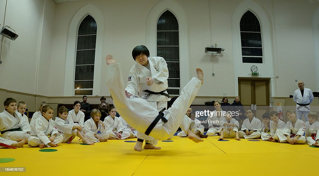 Maki Tsukada demonstrates a throw for the juniors during the Maki Tsukada Fellowship evening at the Northbrook Judo Club, Kingswood Hall, Kingswood Place on March 22, 2013 in Lewisham, London, England..