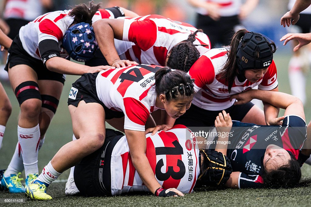 Makiko Tomita of Japan (b) competes against Hong Kong during the Womens Rugby World Cup 2017 Qualifier match between Hong Kong and Japan on December 17, 2016 in Hong Kong, Hong Kong.