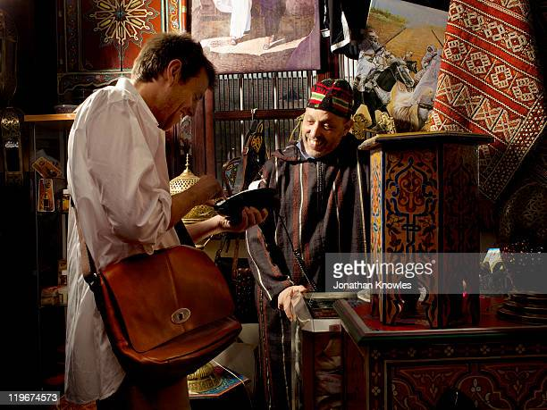 making a card payment in a shop in marocco - souvenir stock pictures, royalty-free photos & images