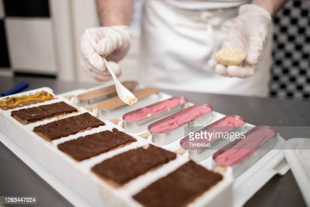 making a chocolate biscuit - nuts models stock pictures, royalty-free photos & images