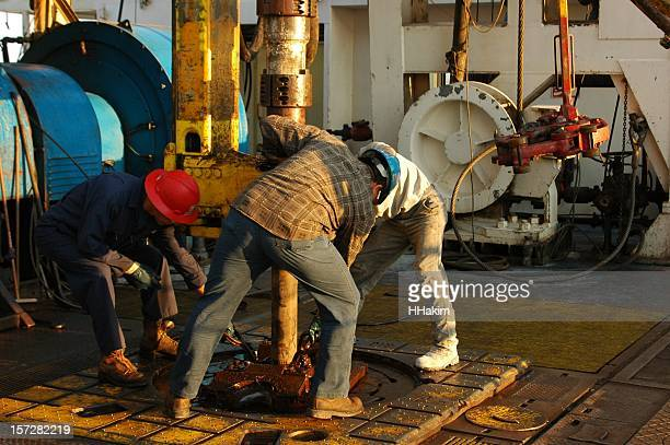 making a connection - oil worker stock pictures, royalty-free photos & images