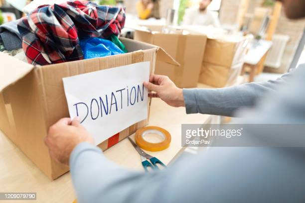 making a good deed - charitable donation stock pictures, royalty-free photos & images