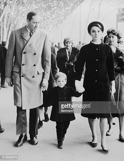 """Making a handsome threesome on the streets of Paris are Mel Ferrer and Audrey Hepburn with their two year old son, Sean. The """"movieland"""" family,..."""