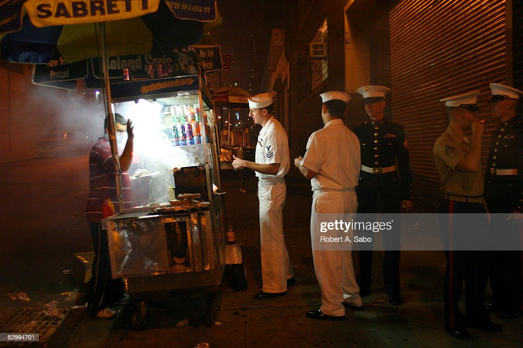 Making a last stop across the street from the piers near the USS Intrepid, Sailors and Marines wait in line for hot dogs before heading back to their ship May 28, 2005 during Fleet Week 2005 in New York City. During the annual Fleet Week over a dozen Navy ships, Coast Guard ships and vessels from all over the world visit New York Harbor. The visiting ships are opened to the public throughout the week.