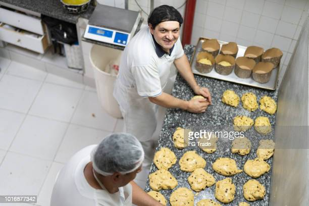 making a panettone on the bakery - panettone foto e immagini stock