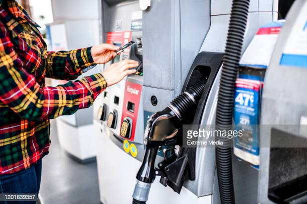 making a payment for gas at a fuel station - gas station stock pictures, royalty-free photos & images