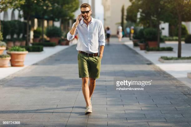 making a phone call - solo un uomo foto e immagini stock