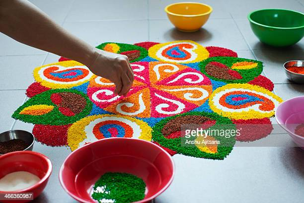 making a rangoli - rangoli stock pictures, royalty-free photos & images