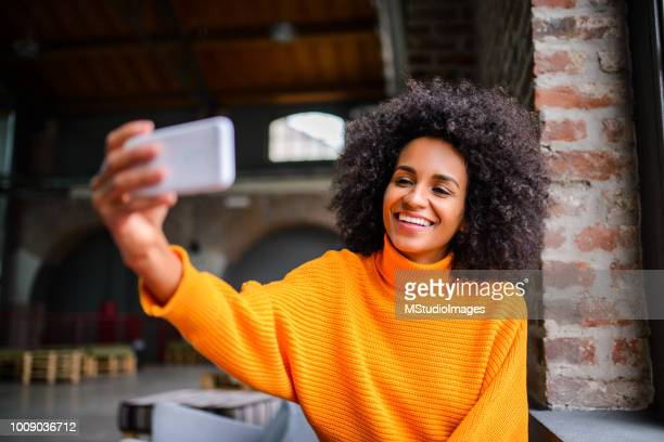 making a self portrait. - influencer stock photos and pictures