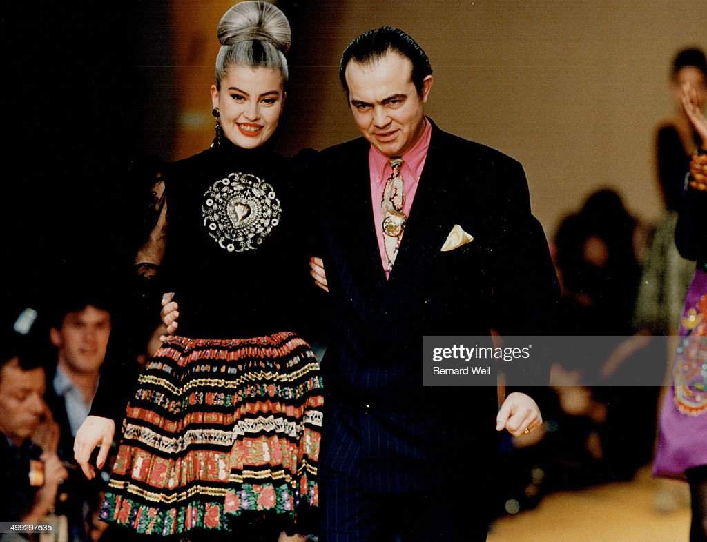 Making a splash: Left; Christian Lacroix and his favorite model; Marie Seznec; in sun-pleat skirt an... : News Photo