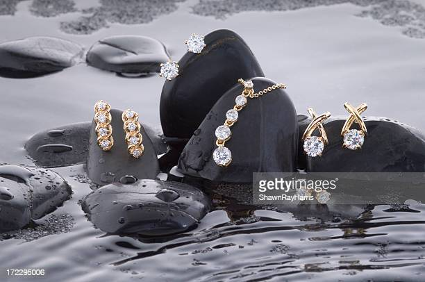 making a splash with gold and diamonds - jewellery stock pictures, royalty-free photos & images