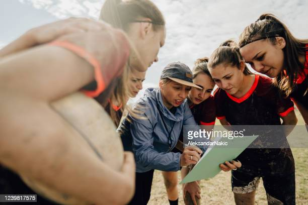 making a strategy of playing - coach stock pictures, royalty-free photos & images
