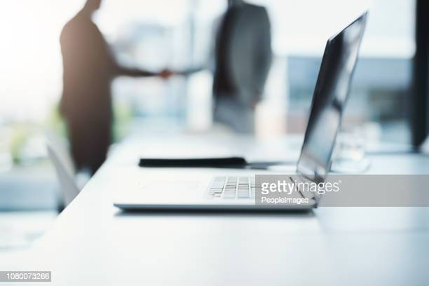 making a success of the day - merger stock photos and pictures