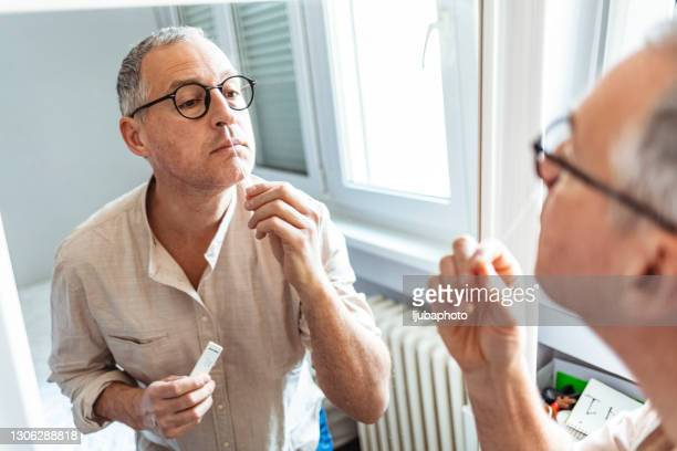 making a swab test - medical examination stock pictures, royalty-free photos & images