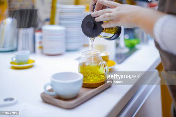 making a tea - chamomile tea stock photos and pictures