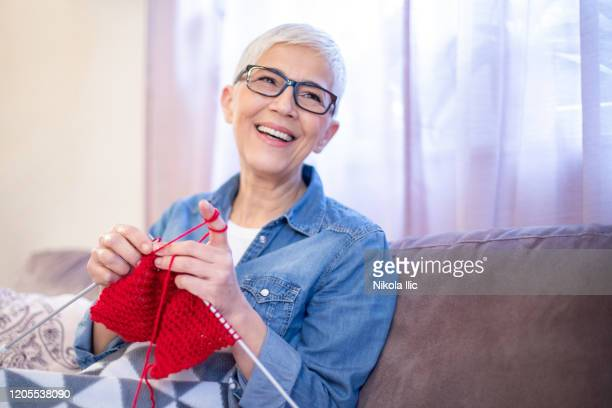 making a warm scarf for the winter - knitting stock pictures, royalty-free photos & images