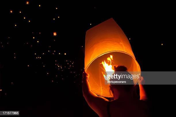 making a wish at loi krathong festival in chiang mai - loi krathong stock photos and pictures