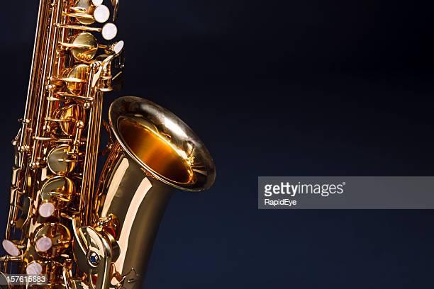 Making beautiful music: golden saxophone against deep blue