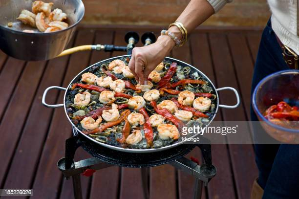 Making Black Paella: Decorating with Grilled Shrimp and Peppers