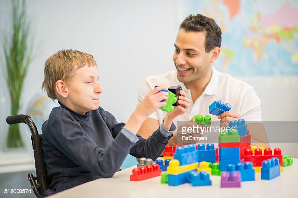 making block towers - social services stock photos and pictures