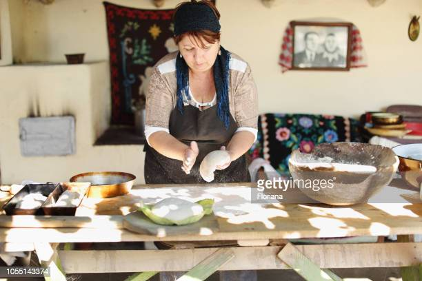 making bread in traditional way - romania stock pictures, royalty-free photos & images