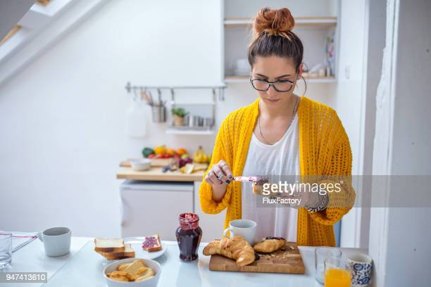 making breakfast in the kitchen - spreading stock pictures, royalty-free photos & images