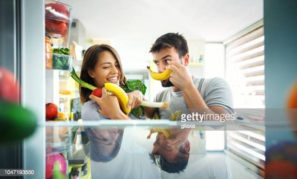 making breakfast is fun. - heterosexual couple stock pictures, royalty-free photos & images