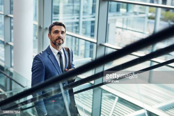 making business his mission - escalator stock pictures, royalty-free photos & images