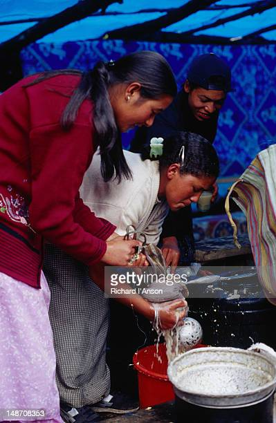 making chhang (tibetan-style beer) in the kitchen of a restaurant at the mani rimdu festival at chiwang gompa (monastery). - mani rimdu festival stock pictures, royalty-free photos & images